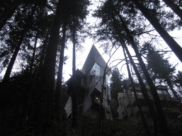 House like a ship's prow above the trail